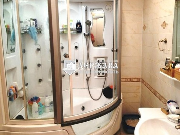 Продам 3-комнатную, 99.6 м², 9 Января ул, 1Б. Фото 16.